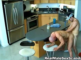 Gay sex on a kitchen